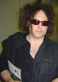 A candid fan photo of The Cure's Robert Smith. Hello is too simple for moments like this unless you look right through the camera to say it