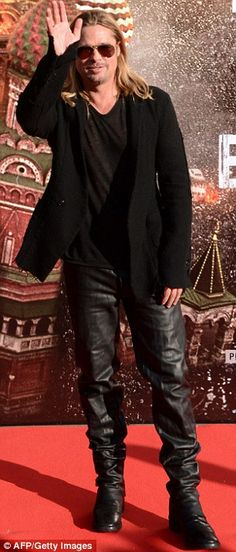Brad Pitt looking like Brad Pitt again; Hell for leather: Brad arrived alone at the Moscow International Film Festival, while his fiancée Angelina Jolie was in Syria