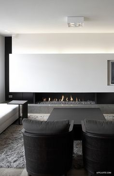 Minimalist Black And White Interior Living Room Space With Modern Fireplace  Stylish_Apartment_in_Duinbergen