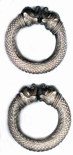 Very large pair of silver bangles with Makhara heads India