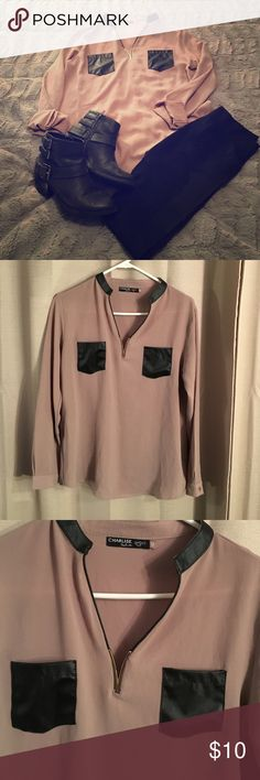 M, Tan, Gold Insert at V-Neck, Black Leather Top Sexy dress shirt. This top features a gold metal insert at the v-neck and has black faux leather front pockets and collar trim. It is in great shape. Says it is a size 42 which would be a 12 in the US but it fits more like an 8/10 or Medium. Charlise Tops Blouses