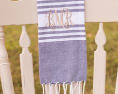These sweet, little monogrammed tea towels will put a personalized touch to any bathroom or kitchen. With a ruffled edge, these decorative hand towels are light-weight and can delicately lay over another towel without being too bulky. The embroidered linens make a memorable gift for weddings, housewarmings and birthdays! Paired with hand soap, a bottle of wine, or the cooks favorite kitchen utensils - these monogrammed towels make the most lovely hostess gift. ---PRODUCT DETAILS…