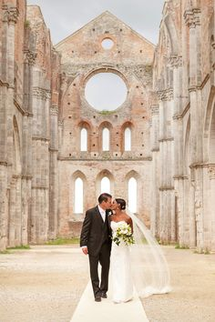 Picture of bride and groom walking inside the abbey in Chiusdino