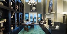 The Belmont (9017): Classicly styled study with two story ceilings and fireplace