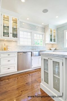 glass-front cabinets + wood floor + glass subway tile