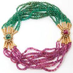 Necklace form: 18 Karat Gold, Platinum, Ruby, Emerald and Diamond Necklace-Bracelet Combination, René Boivin, Circa 1950. The first bracelet composed of nine strands of ruby beads measuring...