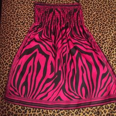 Short silky zebra print dress Short silky (polyester) zebra pink dress, dark pink and black, barely worn size small, stretchy top Wet Seal Dresses Mini