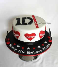 One Direction cake in black, white and red.