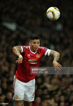 Marcos Rojo of Manchester United takes a throw-in during the UEFA Europa League Round of 16 Second Leg match between Manchester United and Liverpool at Old Trafford on March 17, 2016 in Manchester, England.