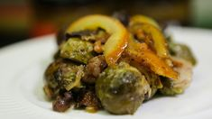Roasted Brussels Sprouts with Walnuts and Oranges - http://goodtaste.tv/recipes/showrecipe/display/roasted-brussels-sprouts-with-walnuts-and-te-oranges