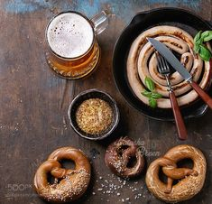 Lager beer with sausage and pretzels by NatashaBreen
