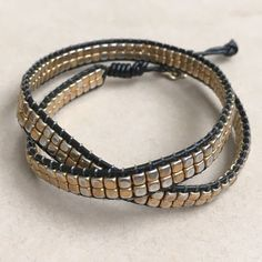 Stella & Dot Gold Nugget Leather Wrap Bracelet Black leather & gold plated beads. Button closure with 2 slots for adjusting length. Plating has wear. Leather has some stretch marks. Stella & Dot Jewelry Bracelets