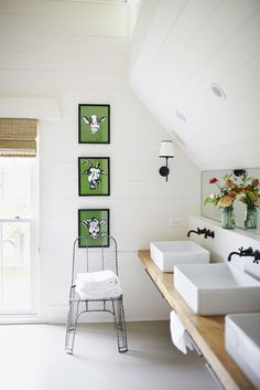 Another bathroom: love everything about this one -- three vessel sinks // natural wood vanity // cow + goat prints // faucets // wire chair // sloped ceiling // natural shade // floor (although wood would be fine too) // towel rack // sconces // ceiling-to-floor windows // LOVE IT!!