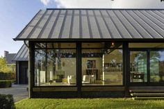 Standing seam metal roof and post + beam construction.
