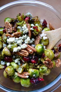 Great Salad . No recipe but looks like roasted brussels sprouts, pecans, dried cranberries or dried cherries, feta or blue cheese, probably a little honey, lemon, salt,  pepper.  We like brussels sprouts but having them in a salad would be different.