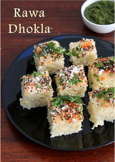 I never knew we could make dhokla with Rawa.I have only seen the yellow co. Spicy Recipes, Vegetarian Recipes, Snacks Recipes, Yummy Recipes, Dhokla Recipe, Indian Snacks, International Recipes, Salmon Burgers, Appetizers