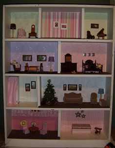 Doll House made out of a bookshelf! TOTALLY a great idea for a fun project with the kids!