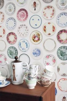 Saucers for the wall...i probably have enough stored in my china cabinet to do this if i wanted to.