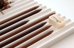 chocolate 'pencils' with a sharpener for grating, also by Nendo