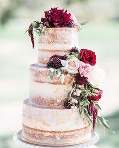 Gold leaf on naked wedding cake adorned with burgundy flowers #rusticwedding #nakedweddingcakes