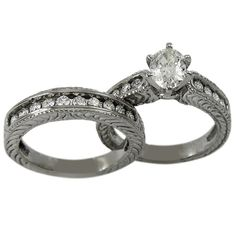 Antique Engagement Setting With Channel Accents And Engraved Shanks -  Both pieces are set with a total of 0.80ct of brilliant round diamonds and the engagement ring can accommodate any shape and size center diamond.    This antique wedding set has channel set diamonds. The side walls of the ring have a beautiful pattern engraved on them.    At Dacarli emphasis is placed on design, quality, and modern, high-tech manufacturing techniques. Our rings have thick and durable shanks which will...