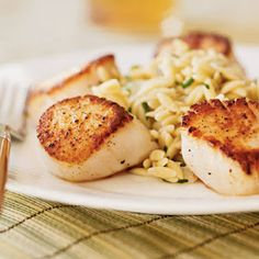 "Be sure to pour the scallops and ""sauce"" over the orzo- and add all the lemon juice.  So good!"