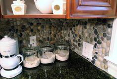 DIY river rock backsplash for kitchens