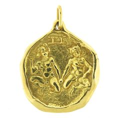 Cartier Gold Gemini Zodiac Pendant | From a unique collection of vintage necklace enhancers at https://www.1stdibs.com/jewelry/necklaces/necklace-enhancers/