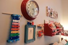 What a fun grouping for a kid's wall. And the toys attach by velcro, so they can still be played with!