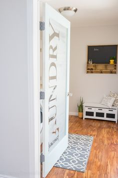 Reveal {Before and After Photos} LOVE this Laundry Room door! She uses vinyl letters then frosted the glass for…LOVE this Laundry Room door! She uses vinyl letters then frosted the glass for… Laundry Room Doors, Laundry Room Remodel, Laundry Room Design, Laundry In Bathroom, Small Laundry, Basement Laundry, Closet Doors, Laundry Closet, Basement Flooring