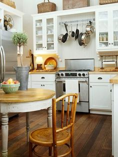 Storage and layout.  http://www.bhg.com/kitchen/color-schemes/neutrals/reasons-to-love-white-kitchens/#page=2