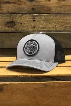 44325853c9524 Deep River Round Patch on heather grey with black mesh Richardson Hat with  cotton polyester front