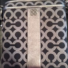 Coach crossbody purse Silver and black, pink satin interior. Perfect condition!! Coach Bags Crossbody Bags