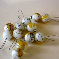 These stitch markers are just like jewelry for your knitting! Made with beautiful ceramic beads, they are perfect for showing your love of