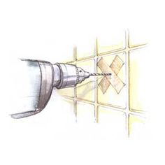 Go get a drywall screw and a hammer. Place the tip of the screw exactly where you want to drill, then tap it ever so gently with the hammer to pierce the glaze and create a little divot. Now load a masonry bit into your drill driver and use the divot to hold it in place as you start drilling. No fissures, no scratches, no fuss. How to Keep Tile From Cracking