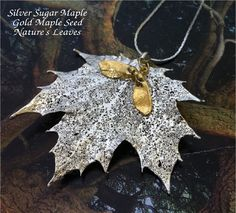 Real Leaf Jewelry,Sugar Maple Leaf and Maple Seed Pendant, 24K gold and iridescent copper. $21.95, via Etsy.