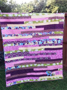 it's a race quilt - jelly roll quilt purple