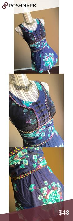 """🎉30% OFF BUNDLES🎉Free People Boho Tank Free People Belted Boho Tank. Navy blue with turquoise flowers and purple accents. Lace bust with toggle buttons. Size 2. Zips on the side. Bust 30"""". Waist 26"""". Shoulder to hem length 26"""". Free People Tops Tank Tops"""