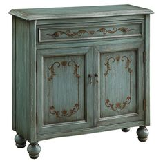 Wood accent chest in teal with hand-painted gold accents and 1 shelf.    Product:   ChestConstruction Material: Birc...