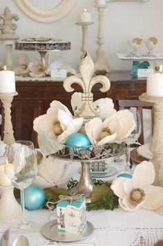 This table works for anyone from Louisiana.  Beautiful magnolia blooms and Fleur-de-lis (Go Saints!). Love the silver, creams & whites with a pop of blue!