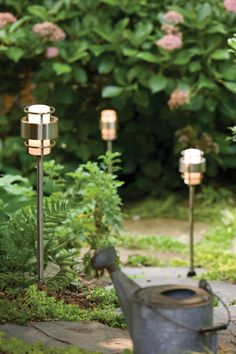 Outdoor kitchens need outdoor lighting. We recommend measuring the entire length of your backyard walkway and placing one path light every 5 to 6 six feet. (Pictured here: Hinkley Lighting, Saturn Chrome Tiki Lights) Outdoor Path Lighting, Exterior Lighting, Landscape Lighting, Outdoor Decor, Lighting Ideas, Outdoor Spaces, Outdoor Kitchens, Outdoor Stuff, Outdoor Ideas