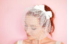 White polka dot bridal blusher with a big silk bow by Joliejye, €49.90