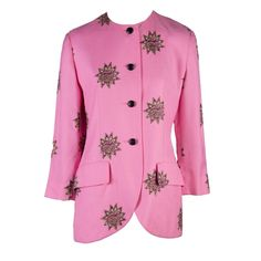 PInk blazer with brown, gold and black embroidered Suns. Two front pockets with flaps, no collar, three button closure | Marc Bohan for Christian Dior | France, 1970's