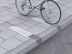 This unobtrusive bike rack takes up no space when there isn't a bike pinned to it. | 33 Ingeniously Designed Products You Need In Your Life: