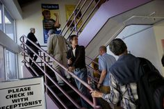 Clients planning to attend a meeting of the AASCEND climb the stairs at The Arc building on Howard Street. A meeting of the AASCEND, which is a group in the autism spectrum, met at the The Arc in San Francisco, Calif. Wednesday April 1, 2015. Photo: Brant Ward, The Chronicle