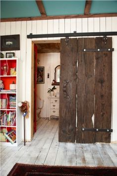 barn door sliding door in a shipping container house. hum