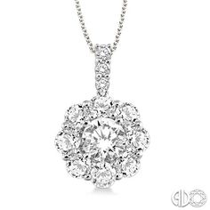 Flower cluster diamond pendant necklace in 14k white gold. 1 carat total weight.