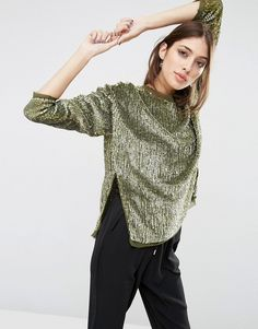 No matter what silhouette you choose, now is the time to infuse a little  shine into your everyday wardrobe.Balance is the key to avoid looking  over-the-top: style a sequin top with high-waisted jeans, a sequin dress  with a checked-oversized blazer,or a pair slouchy sequin pants with a  classic cotton t-shirt.