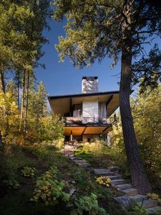 This modern lake house retreat designed by Olson Kundig Architects is located in Whitefish, Montana. Decks, Modern Lake House, Architectural Services, Exterior Siding, Architect House, Indoor Outdoor Living, Cabins In The Woods, Open Plan Living, Sustainable Design