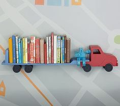 How many of us mommy's have been to a craft fair and own a wooden truck that we can't bare to throw away, yet our boys are too big too even LOOK at it anymore?! Refurbish it into this for a relative and breathe new life into it! How easy this would be! No skill required other than some basic knowledge on how to screw on a bracket and attach to your wall :D wTruck Shelf pbkids